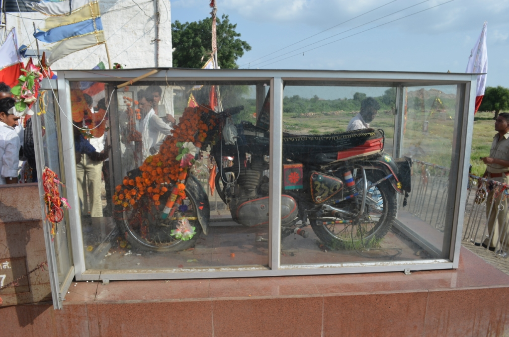 bike of om banna in glass box