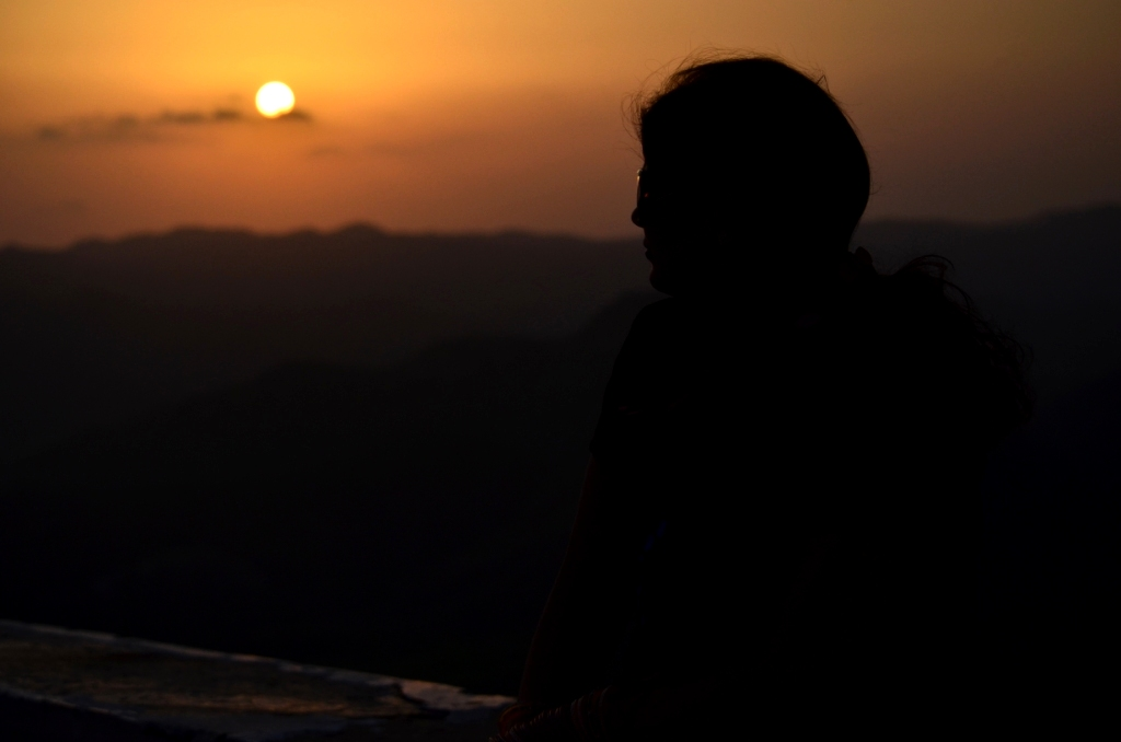 My wife enjoying the Sunset from Sajjan Garh Fort